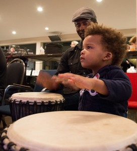 Dad and child at the drumming circle