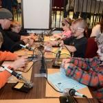 Kids soldering electronic kits at Madlab workshop